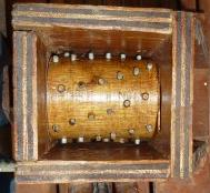 The inside of a traditional scratter - the toothed cam is for pulping apples for cider. This scratter can be made from our simple plans  @ www.jamesandtracy.co.uk