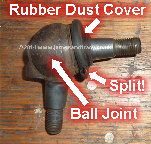 A split rubber dust cover on a Mercedes front suspension lower ball joint that will soon fail